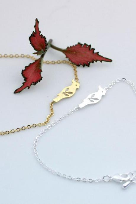 Parrot and Leaves Pendant Bracelet in gold / silver