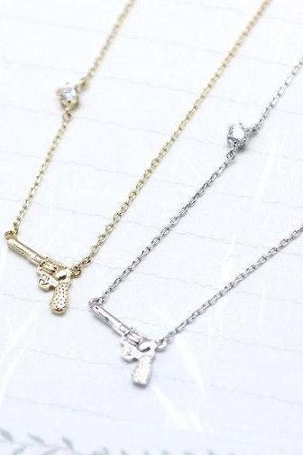 Gun with crystal stone silver necklace in Gold / Silver