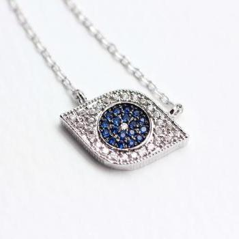 EVIL EYE Pendant Necklace detailed in Swarovski Blue setting Silver